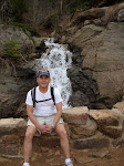 Me at the stream as it goes higher than Gold Camp Road