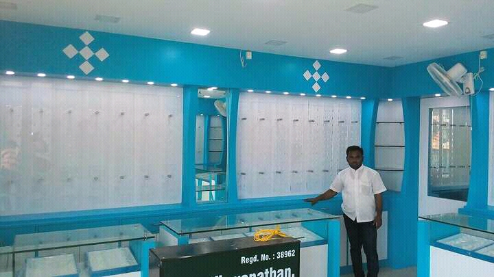 Contractors in chennai shops interiors optical interior for Optical store designs interior