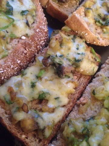 Cheese on toast with coriander, onions and spices