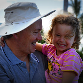 Father and daughter having fun! by Jodie Graham - Babies & Children Child Portraits ( laughing, fun, smile, sea world, together )