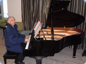 Claude Moffat playing the Yamaha mini-grand piano.