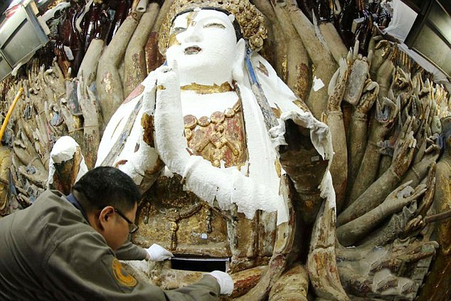 800-year-old Buddhist statue of 'goddess with thousand hands' restored to former glory