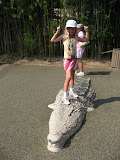 Hannah standing on an alligator at the Nashville Zoo 09032011