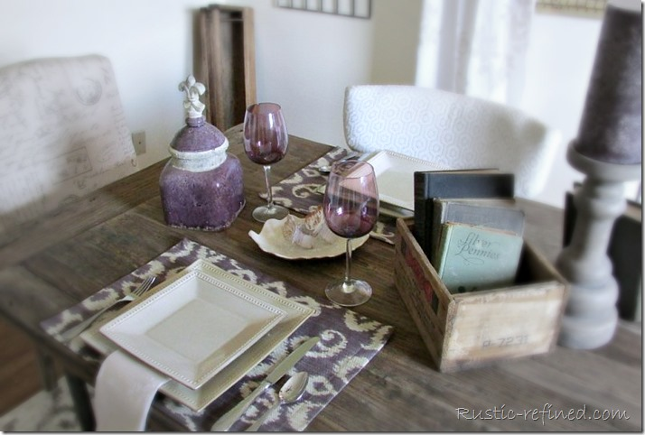 Touches of purple and browns make the perfect setting on a barn wood table