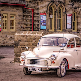Moggy by Darrell Evans - Transportation Automobiles ( car, old, automobile, chrome, stone, yellow, parked, morris minor, transport, nikon, classic, black, signs, building, morris, station, wheels, white, windows, haworth, red, headlights, d7100, worth valley, wall,  )