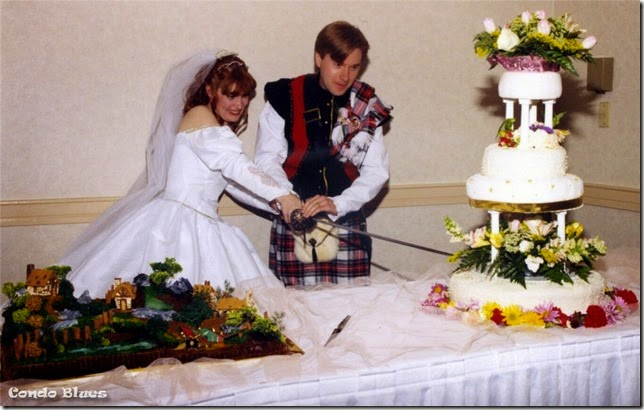 cut wedding cake with sword