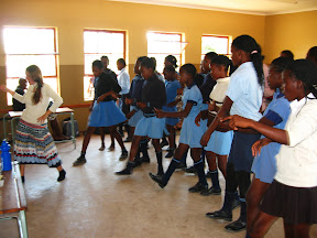 Lora teaching dance steps to the dance and drama club at Welani.