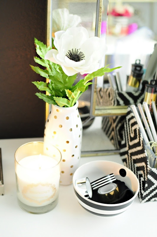 A black, white and gold home office filled with thrifted, DIY and bargain finds. So many beautiful accessories makes the space feel glamorous and inviting.