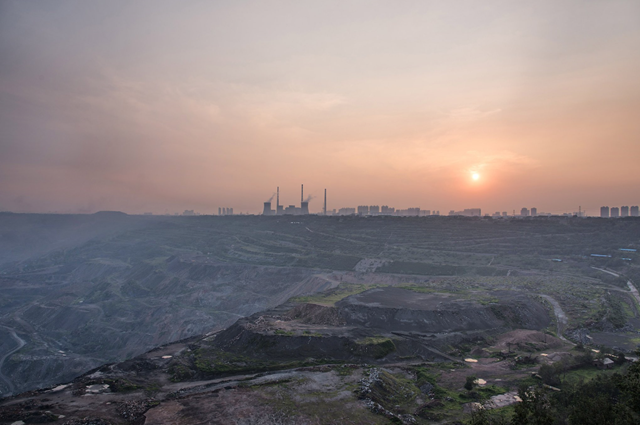 The Haizhou coal mine in Fuxin, in northeastern China, was shut down at the end of 2014. Chinese leaders want the country's emissions to stop growing by 2030. Photo: Xiao Lu Chu / Getty Images