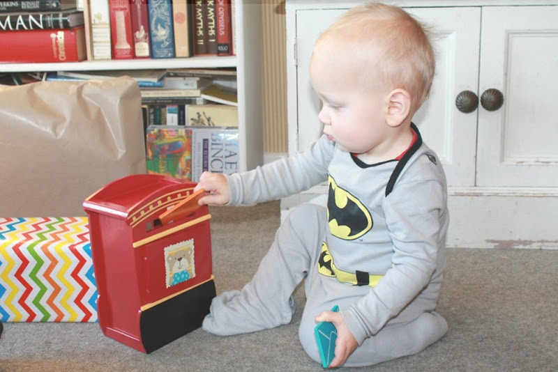 baby-playing-with-toy-postbox