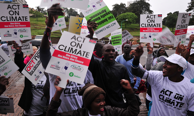Hundreds of people with placards take part in demonstration calling for climate change justice for Africa in Nairobi, 14 November 2015. Photo: Simon Maina / AFP / Getty Images