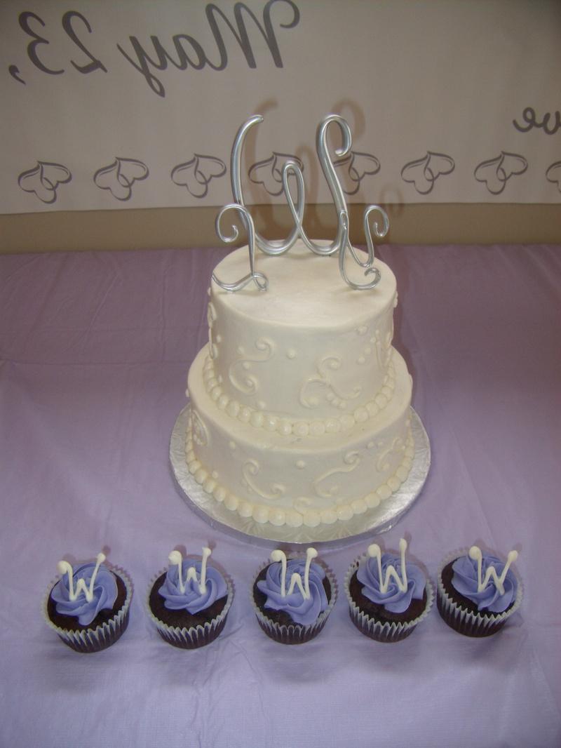 2 tiered pumpkin cake w cream cheese frosting. Scroll swirl design.