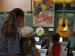 Lori, Hannah and Bryan looking at a display in the Country Music Hall of Fame in Nashville TN 09042011