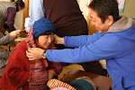Hiro-san passing out some of the hand-knitted items to a grateful lady in Tohoku.