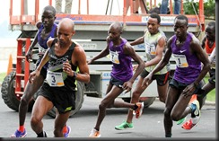 Meb leads the pack.   The Purple shirts are close behind!