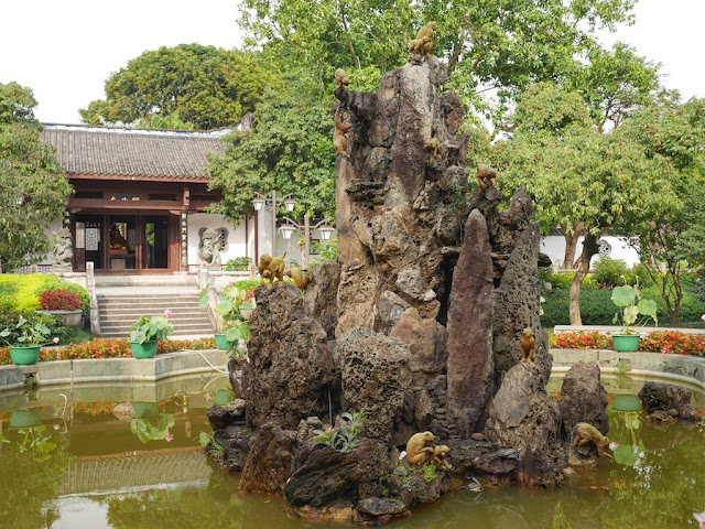 rock formation with sculptures of small monkeys in front of Kaihua Temple in Fuzhou