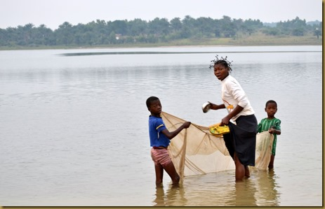 Kids catching fish with net
