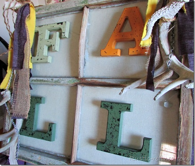 How to turn an Antique wood window into a beautiful piece of hanging art using rope, antlers, cup hooks, strips of fabric and galvanized metal chain.