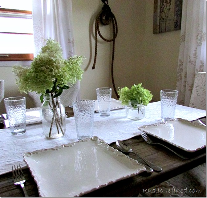SImple white plates setting a beautiful rustic tablescape