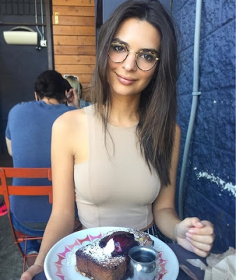 Emily Ratajkowskin Emrata in Donna Mizani Front Panel Crop Top and Faithfull the Brand Bitterweet Striped Open Slits Pants and Glasses