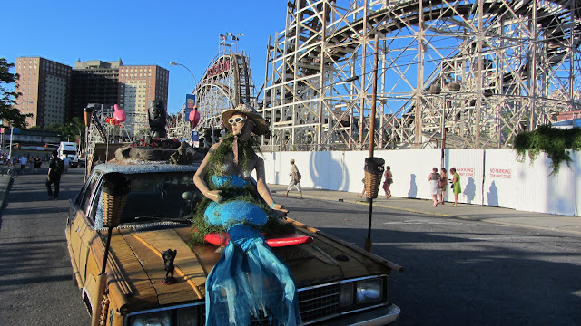 A mermaid by the Coney Island Cyclone roller coaster.