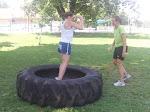 The ladies tackling the big tire.