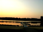 Sunset over the boats and the lake.