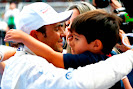 Felipe Massa hugs his family after qualifying on Pole position