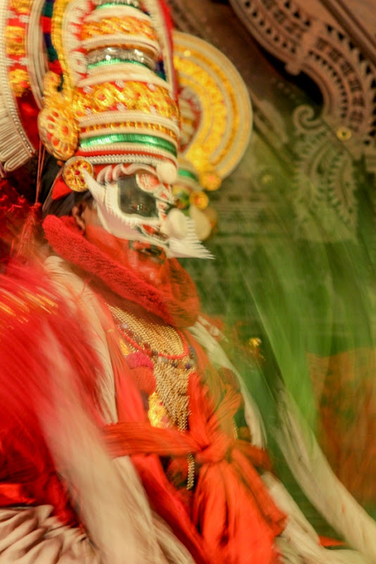 The fall of evil during a Kathakali show