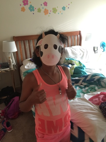 kid wearing cow mask