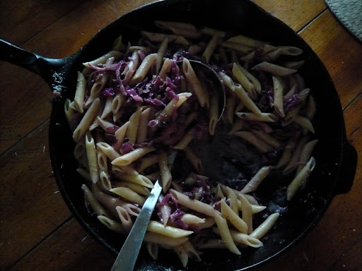 Weeknight dinner pasta. Shredded 1/2 red cabbage, onion, garlic, bacon, chili flakes, lemon rind, currants.