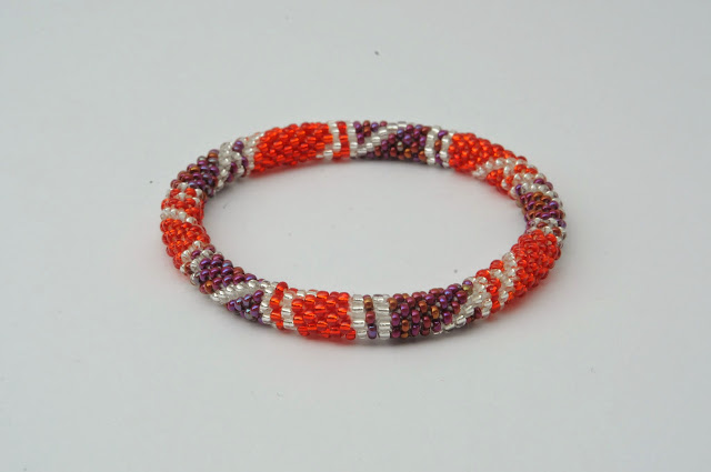 red and purple bracelets