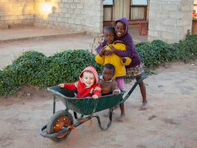 Matimu loved being pushed around in the wheelbarrow with Rosemary's kids.
