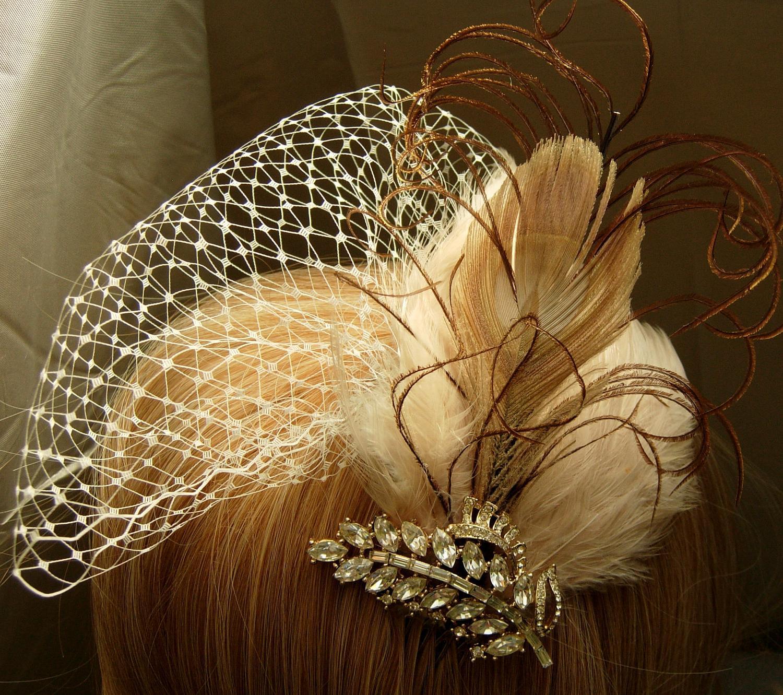 Vintage ivory peacock feathers facinator. From SallysJewelsandgems
