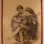 'Mujer tocando la guitarra' de José Luis Orostivar. Carboncillo sobre papel
