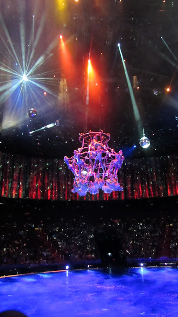 Acrobats spinning high above the stage.