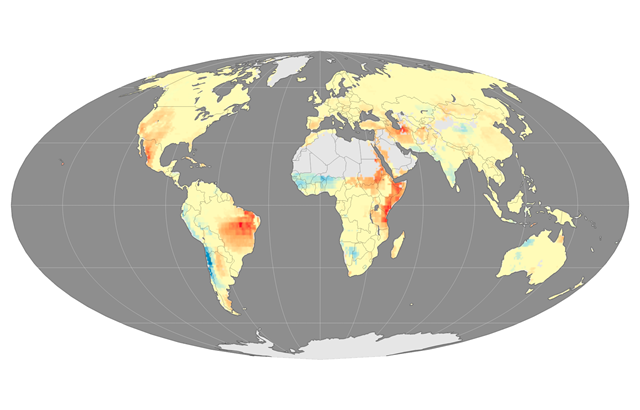 In this map, areas where the fire season lengthened between 1979 and 2014 are shown with shades of orange and red. Areas where the length of the fire season stayed the same are yellow. Shades of blue show where the fire season grew shorter. Gray indicates that there was not enough vegetation to sustain wildfires. Graphic: Jolly, et al., 2015 / Nature Commmunications