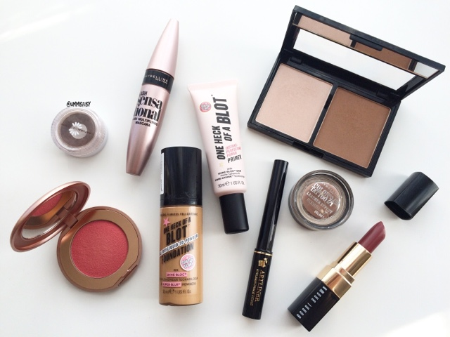 makeup flatlay featuring kiko sleek bobbi brown soap and glory