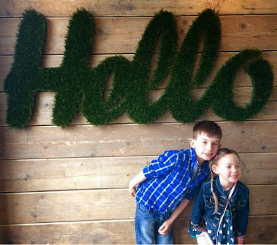 grassy hello sign