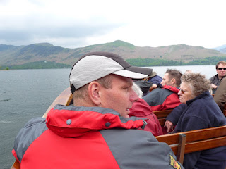 A bit close to Richard I think. The seats on the boat were quite narrow.