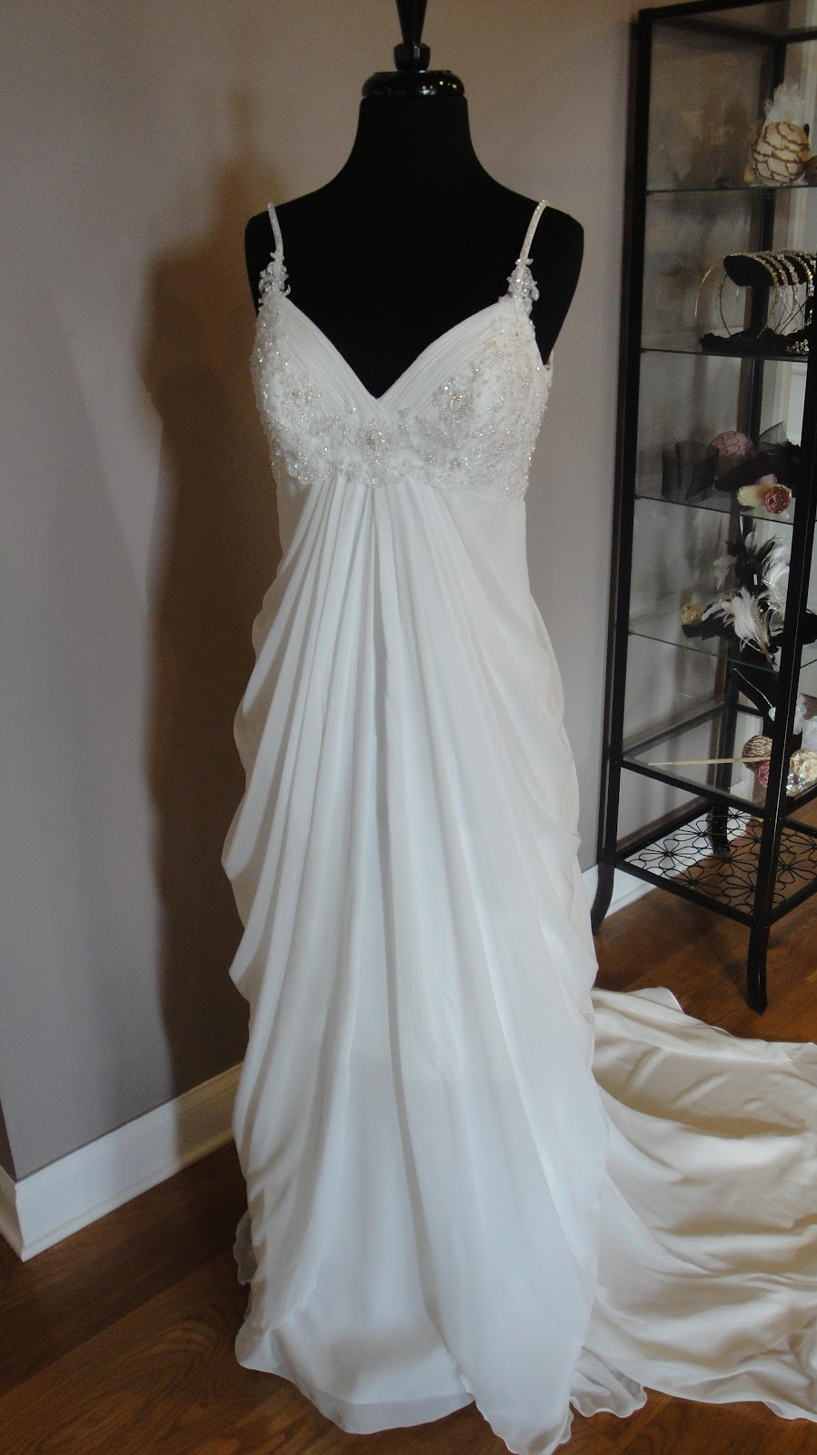 wedding gown features a