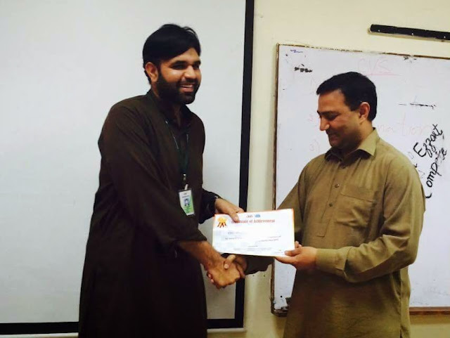 Sir Naeem Recieving cert from HOD at bmb sports gala