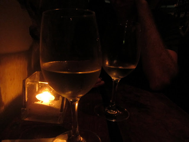 Enjoying a drink at a wine bar in Newtown.