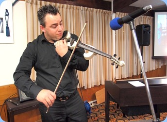 Guest artist, Nick Jones, playing his electric violin. Photo courtesy of Dennis Lyons.