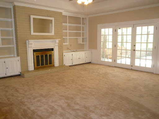 Family Room - Fireplace, french doors, built-in bookcases & cabinets, ceiling fan, pantry closet, crown molding & chair rails, wainscoting, tray ceilings, recessed lighting.
