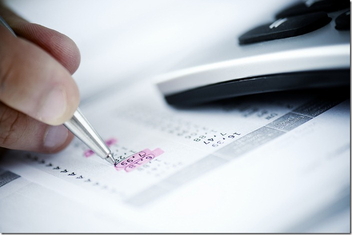 a man calculating invoices