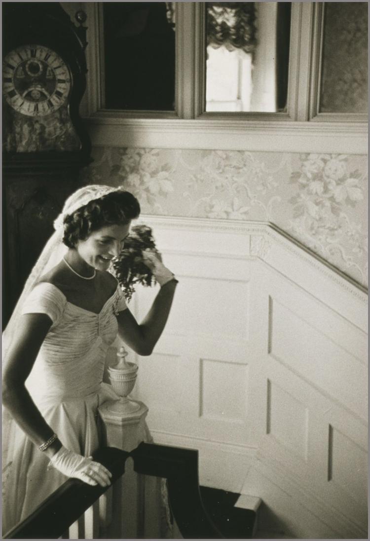 Jacqueline Bouvier waits on