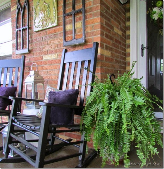 Decorating a small front porch without spending any money. By using what I already had, I managed to decorate my porch using a color scheme consisting of purples, greens and black.