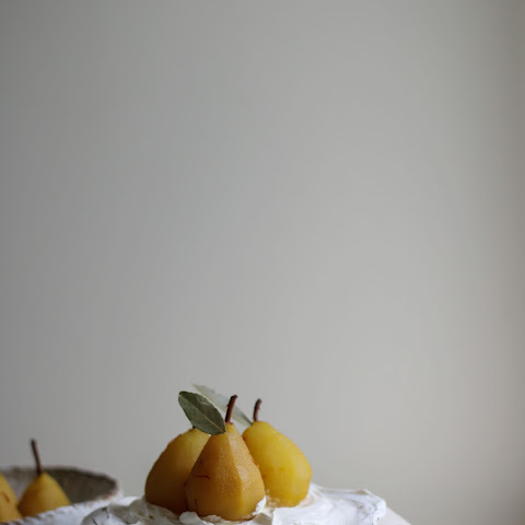 Brown Sugar Pavlova With Saffron Poached Pears And Persimmon
