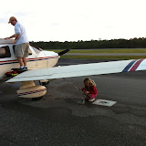 Untying the plane for our trip home from Destin FL 03242012b